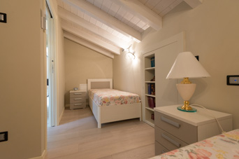 Small furnished bedroom of the Picasso flat